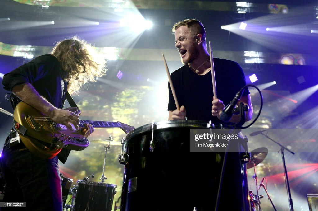 Wayne Sermon (L) and <a gi-track='captionPersonalityLinkClicked' href=/galleries/search?phrase=Dan+Reynolds&family=editorial&specificpeople=8995077 ng-click='$event.stopPropagation()'>Dan Reynolds</a> of Imagine Dragons perform as part of the iTunes Festival at the Moody Theater on March 11, 2014 in Austin, Texas.