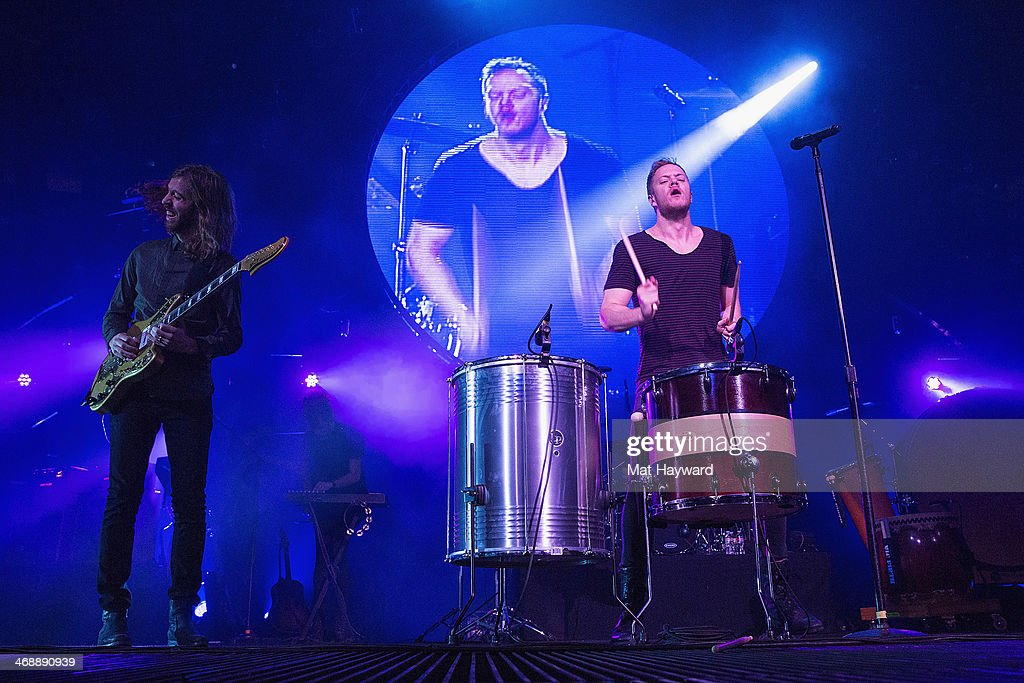 Wayne Sermon (L) and <a gi-track='captionPersonalityLinkClicked' href=/galleries/search?phrase=Dan+Reynolds&family=editorial&specificpeople=8995077 ng-click='$event.stopPropagation()'>Dan Reynolds</a> of Imagine Dragons perform on stage at KeyArena on February 11, 2014 in Seattle, Washington.