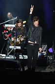 Wayne Sermon and Dan Reynolds of Imagine Dragons perform onstage during the ATT Block Party at the NCAA March Madness Music Festival Ð Day 1 at White...