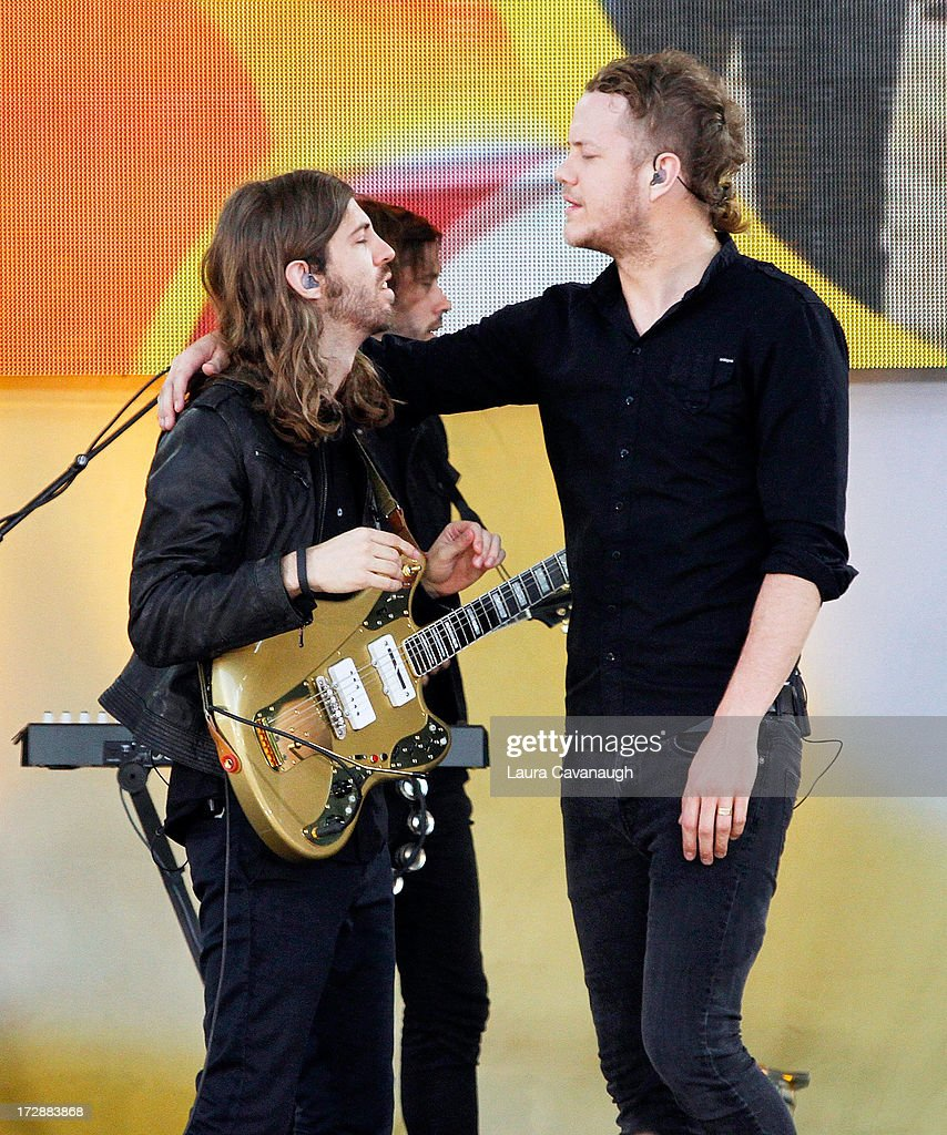 Wayne Sermon and <a gi-track='captionPersonalityLinkClicked' href=/galleries/search?phrase=Dan+Reynolds&family=editorial&specificpeople=8995077 ng-click='$event.stopPropagation()'>Dan Reynolds</a> (R) of Imagine Dragons performs at Rumsey Playfield on July 5, 2013 in New York City.