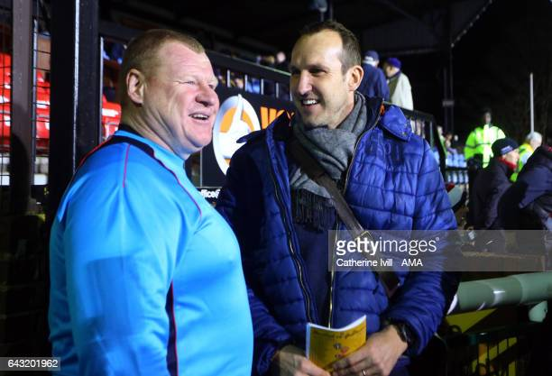 Wayne Shaw of Sutton United talks to goalkeeper Mark Schwarzer before The Emirates FA Cup Fifth Round match between Sutton United and Arsenal on...