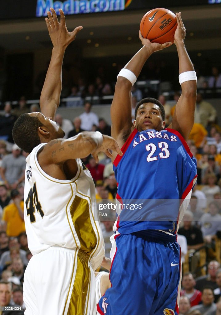 Wayne Simien of the Kansas Jayhawks takes a shot as Kalen Grimes of the Missouri Tigers defends on March 6 2005 at Mizzou Arena in Columbia Missouri