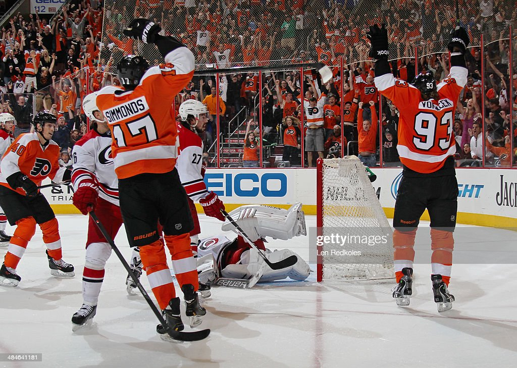 Wayne Simmonds #17 and Jakub Voracek #93 of the Philadelphia Flyers celebrate Simmonds's game-tying goal in the third period against the Carolina Hurricanes on April 13, 2014 at the Wells Fargo Center in Philadelphia, Pennsylvania. The Hurricanes went on to defeat the Flyers 6-5 in a shootout.
