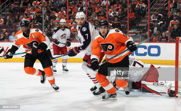 Wayne Simmonds and Valtteri Filppula of the Philadelphia Flyers in action against Sergei Bobrovsky Jack Johnson and David Savard of the Columbus Blue...