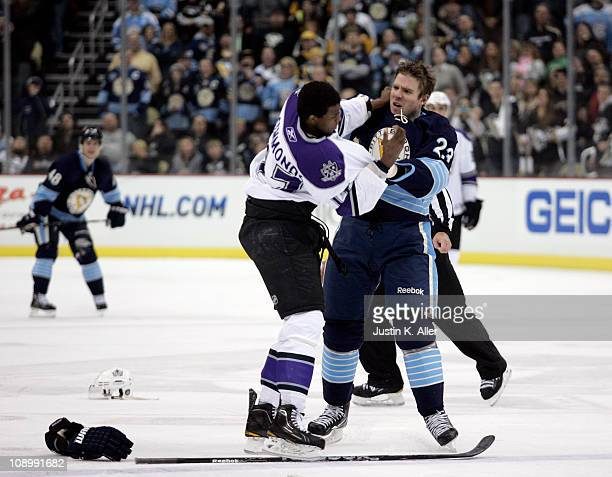 Wayne Simmonds of the Los Angeles Kings mixes it up with Ryan Craig of the Pittsburgh Penguins at Consol Energy Center on February 10 2011 in...