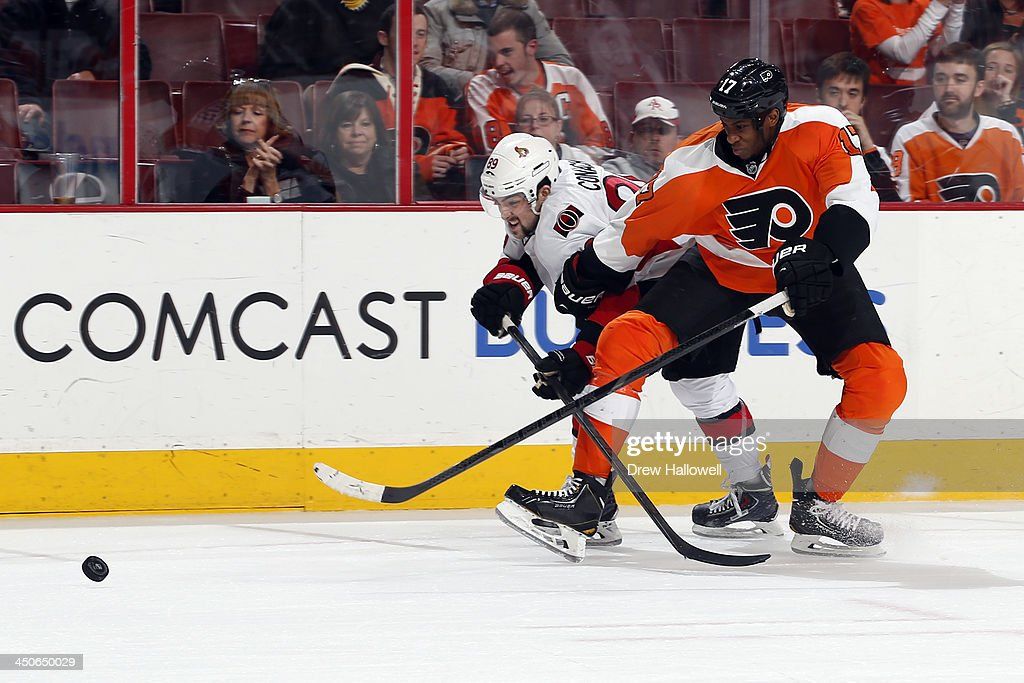 <a gi-track='captionPersonalityLinkClicked' href=/galleries/search?phrase=Wayne+Simmonds&family=editorial&specificpeople=4212617 ng-click='$event.stopPropagation()'>Wayne Simmonds</a> #17 of the Philadelphia Flyers and <a gi-track='captionPersonalityLinkClicked' href=/galleries/search?phrase=Cory+Conacher&family=editorial&specificpeople=8312407 ng-click='$event.stopPropagation()'>Cory Conacher</a> #89 of the Ottawa Senators fight for the puck at the Wells Fargo Center on November 19, 2013 in Philadelphia, Pennsylvania. The Flyers won 5-2.