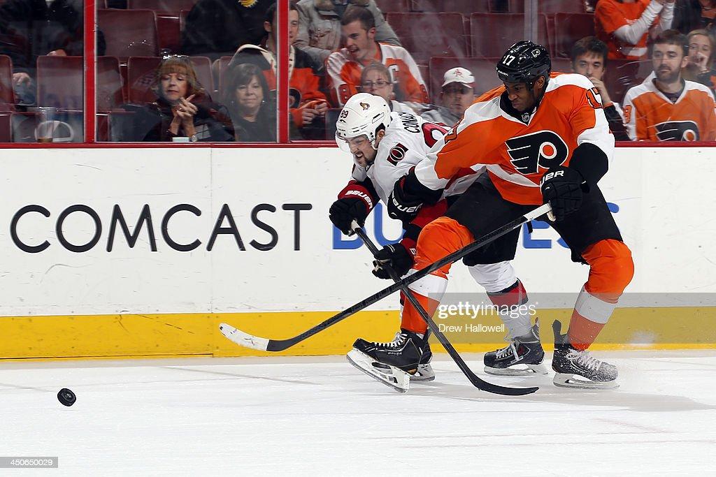 Wayne Simmonds #17 of the Philadelphia Flyers and Cory Conacher #89 of the Ottawa Senators fight for the puck at the Wells Fargo Center on November 19, 2013 in Philadelphia, Pennsylvania. The Flyers won 5-2.