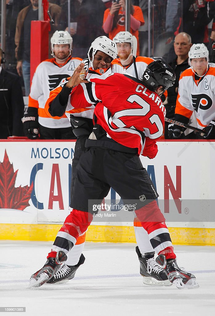 <a gi-track='captionPersonalityLinkClicked' href=/galleries/search?phrase=Wayne+Simmonds&family=editorial&specificpeople=4212617 ng-click='$event.stopPropagation()'>Wayne Simmonds</a> #17 of the Philadelphia Flyers and David Clarkson #23 of the New Jersey Devils fight during the Devils' home opener at the Prudential Center on January 22, 2013 in Newark, New Jersey. The Devils shutout the Flyers 3-0.