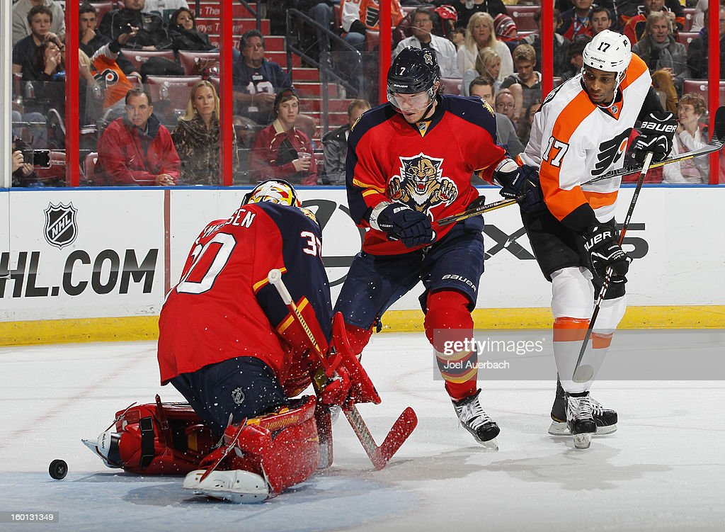 <a gi-track='captionPersonalityLinkClicked' href=/galleries/search?phrase=Wayne+Simmonds&family=editorial&specificpeople=4212617 ng-click='$event.stopPropagation()'>Wayne Simmonds</a> #17 of the Philadelphia Flyers and Dmitry Kulikov #7 of the Florida Panthers look on as the puck shot by Luke Schenn #22 (not pictured) scores past goaltender <a gi-track='captionPersonalityLinkClicked' href=/galleries/search?phrase=Scott+Clemmensen&family=editorial&specificpeople=214674 ng-click='$event.stopPropagation()'>Scott Clemmensen</a> #30 at the BB&T Center on January 26, 2013 in Sunrise, Florida. The Flyers defeated the Panthers 7-1.