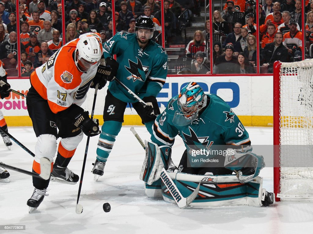 Wayne Simmonds #17 of the Philadelphia Flyers attempts a scoring chance against Marc-Edouard Vlasic #44 and goaltender Aaron Dell #30 of the San Jose Sharks on February 11, 2017 at the Wells Fargo Center in Philadelphia, Pennsylvania. The Flyers went on to defeat the Sharks 2-1 in overtime.