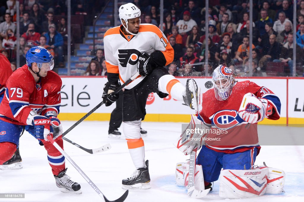 <a gi-track='captionPersonalityLinkClicked' href=/galleries/search?phrase=Wayne+Simmonds&family=editorial&specificpeople=4212617 ng-click='$event.stopPropagation()'>Wayne Simmonds</a> #17 of the Philadelphia Flyers attempts to screen on <a gi-track='captionPersonalityLinkClicked' href=/galleries/search?phrase=Peter+Budaj&family=editorial&specificpeople=228123 ng-click='$event.stopPropagation()'>Peter Budaj</a> #30 of the Montreal Canadiens during the NHL game at the Bell Centre on February 16, 2013 in Montreal, Quebec, Canada.