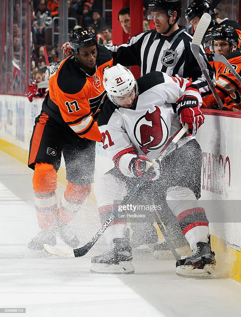 <a gi-track='captionPersonalityLinkClicked' href=/galleries/search?phrase=Wayne+Simmonds&family=editorial&specificpeople=4212617 ng-click='$event.stopPropagation()'>Wayne Simmonds</a> #17 of the Philadelphia Flyers battles along the boards with <a gi-track='captionPersonalityLinkClicked' href=/galleries/search?phrase=Kyle+Palmieri&family=editorial&specificpeople=4783296 ng-click='$event.stopPropagation()'>Kyle Palmieri</a> #21 of the New Jersey Devils on February 13, 2016 at the Wells Fargo Center in Philadelphia, Pennsylvania.