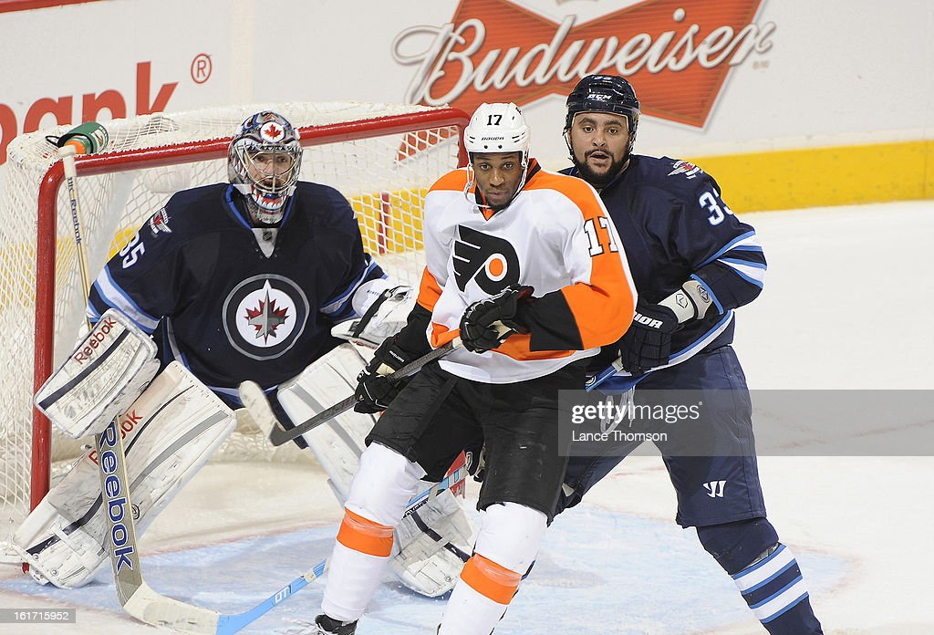 <a gi-track='captionPersonalityLinkClicked' href=/galleries/search?phrase=Wayne+Simmonds&family=editorial&specificpeople=4212617 ng-click='$event.stopPropagation()'>Wayne Simmonds</a> #17 of the Philadelphia Flyers battles for position against <a gi-track='captionPersonalityLinkClicked' href=/galleries/search?phrase=Dustin+Byfuglien&family=editorial&specificpeople=672505 ng-click='$event.stopPropagation()'>Dustin Byfuglien</a> #33 of the Winnipeg Jets in front of goaltender <a gi-track='captionPersonalityLinkClicked' href=/galleries/search?phrase=Al+Montoya&family=editorial&specificpeople=213916 ng-click='$event.stopPropagation()'>Al Montoya</a> #35 during second period action at the MTS Centre on February 12, 2013 in Winnipeg, Manitoba, Canada. The Flyers defeated the Jets 3-2.