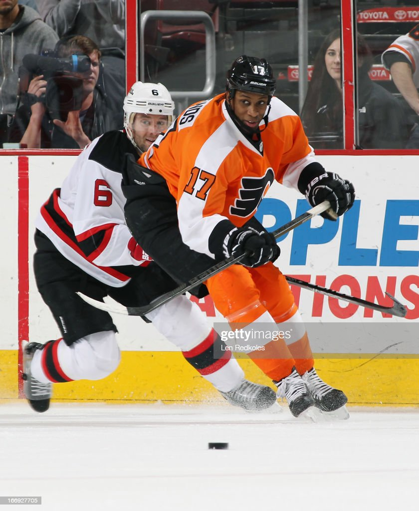 <a gi-track='captionPersonalityLinkClicked' href=/galleries/search?phrase=Wayne+Simmonds&family=editorial&specificpeople=4212617 ng-click='$event.stopPropagation()'>Wayne Simmonds</a> #17 of the Philadelphia Flyers battles for the loose puck with <a gi-track='captionPersonalityLinkClicked' href=/galleries/search?phrase=Andy+Greene&family=editorial&specificpeople=3568726 ng-click='$event.stopPropagation()'>Andy Greene</a> #6 of the New Jersey Devils on April 18, 2013 at the Wells Fargo Center in Philadelphia, Pennsylvania.