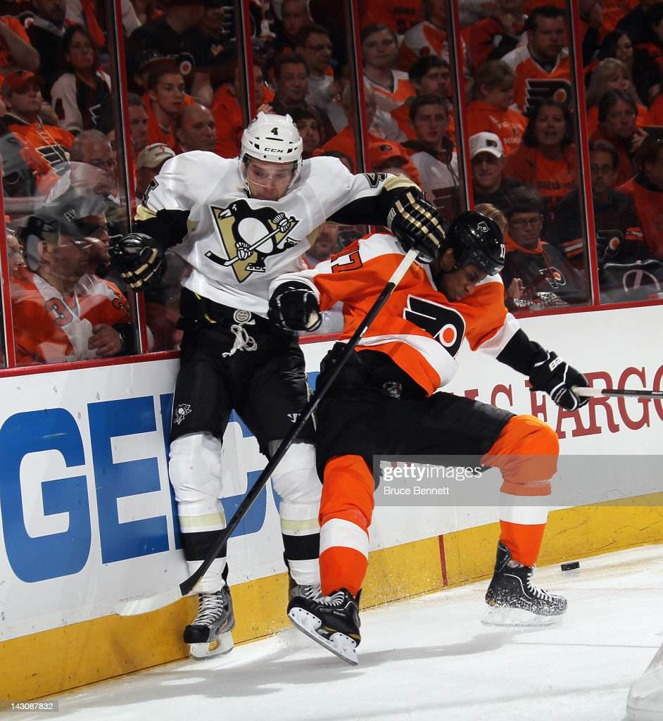 Wayne Simmonds #17 of the Philadelphia Flyers bounces off Zbynek Michalek #4 of the Pittsburgh Penguins in Game Four of the Eastern Conference Quarterfinals during the 2012 NHL Stanley Cup Playoffs at Wells Fargo Center on April 18, 2012 in Philadelphia, Pennsylvania. The Penguins defeated the Flyers 10-3.