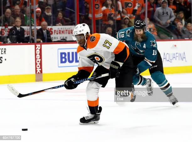 Wayne Simmonds of the Philadelphia Flyers breaks away as Joe Thornton of the San Jose Sharks defends in overtime against the San Jose Sharks on...