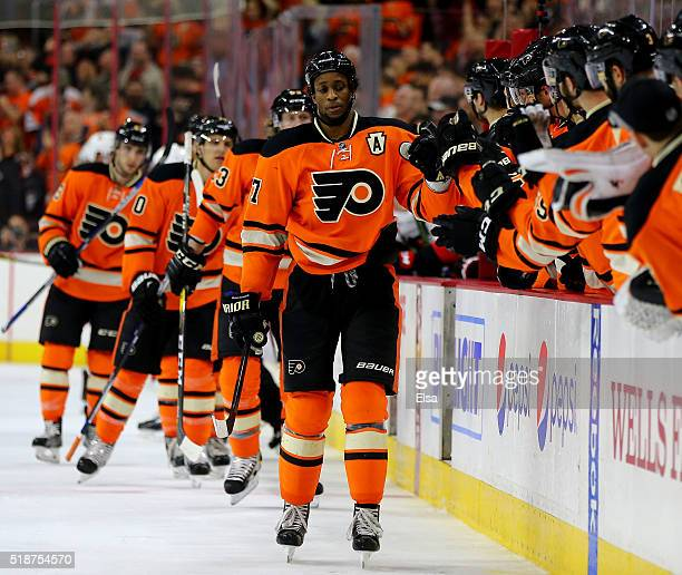 Wayne Simmonds of the Philadelphia Flyers celebrates his goal with teammates on the bench in the third period against the Ottawa Senators at the...