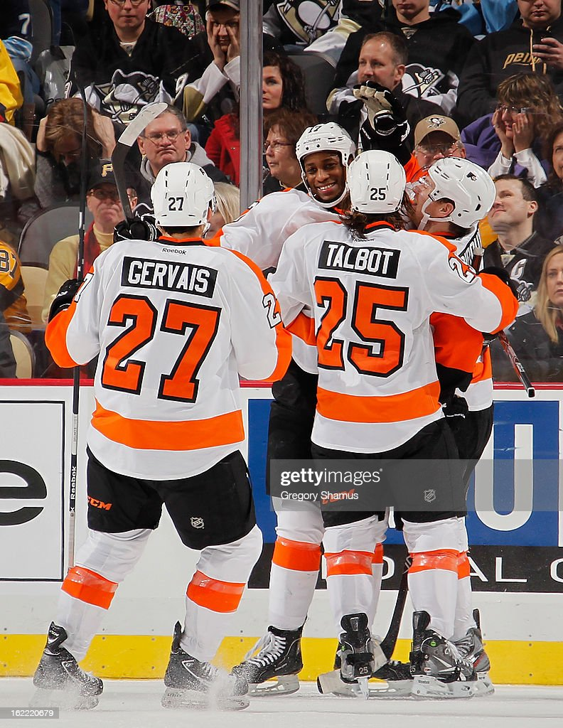 Wayne Simmonds #17 of the Philadelphia Flyers celebrates his second goal of the game with Bruno Gervais #27 and Maxime Talbot #25 during the third period against the Pittsburgh Penguins on February 20, 2013 at Consol Energy Center in Pittsburgh, Pennsylvania.