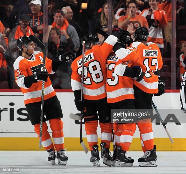 Wayne Simmonds of the Philadelphia Flyers celebrates his second period goal with teammates Shayne Gostisbehere Claude Giroux and Valtteri Filppula...
