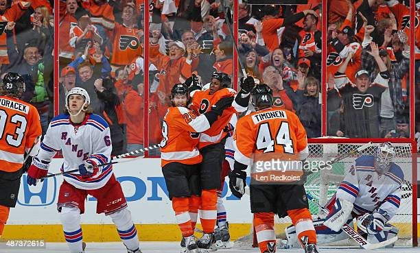 Wayne Simmonds of the Philadelphia Flyers celebrates his third goal of the game against Henrik Lundqvist of the New York Rangers with teammates Jakub...