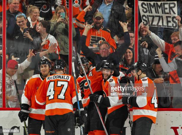 Wayne Simmonds of the Philadelphia Flyers celebrates his third period goal against the Carolina Hurricanes with Valtteri Filppula Andrew MacDonald...