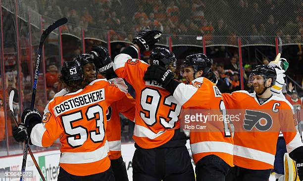 Wayne Simmonds of the Philadelphia Flyers celebrates with teammates after scoring a second period goal against the Buffalo Sabres at Wells Fargo...