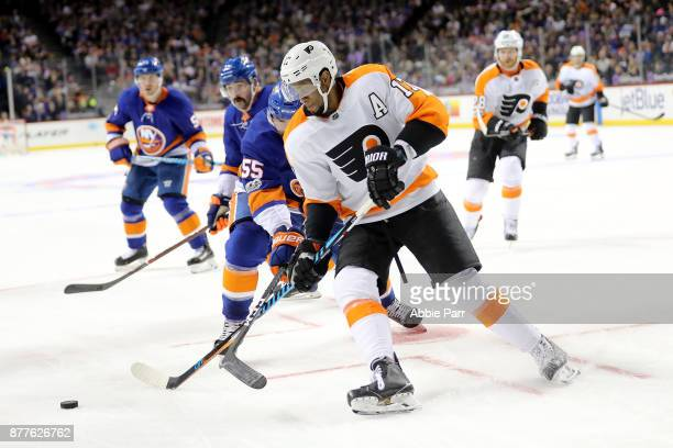 Wayne Simmonds of the Philadelphia Flyers chases the puck against Johnny Boychuk of the New York Islanders in the third period during their game at...