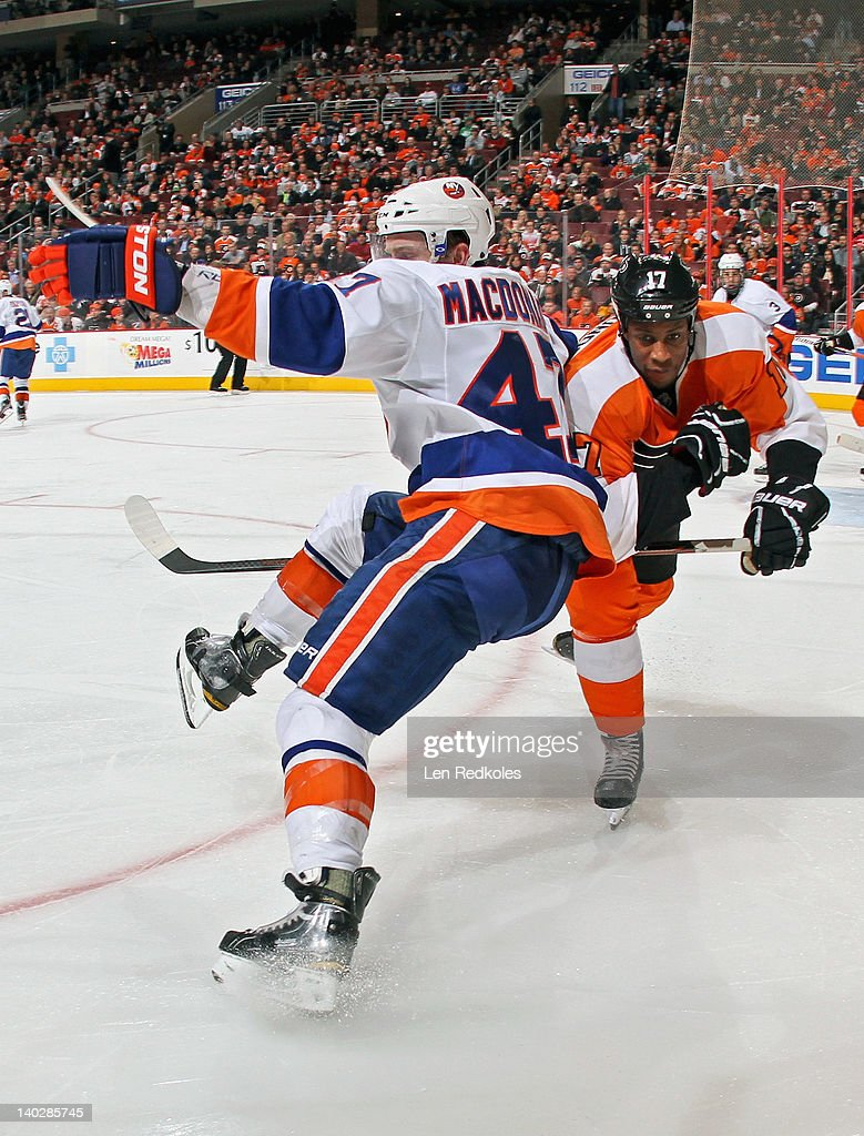 <a gi-track='captionPersonalityLinkClicked' href=/galleries/search?phrase=Wayne+Simmonds&family=editorial&specificpeople=4212617 ng-click='$event.stopPropagation()'>Wayne Simmonds</a> #17 of the Philadelphia Flyers checks Andrew MacDonald #47 of the New York Islanders in the corner on March 1, 2012 at the Wells Fargo Center in Philadelphia, Pennsylvania. The Flyers went on to defeat the Islanders 6-3.