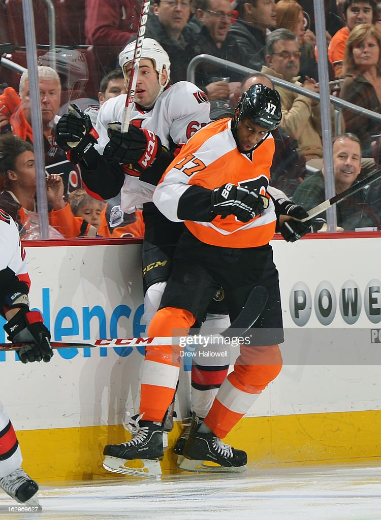 <a gi-track='captionPersonalityLinkClicked' href=/galleries/search?phrase=Wayne+Simmonds&family=editorial&specificpeople=4212617 ng-click='$event.stopPropagation()'>Wayne Simmonds</a> #17 of the Philadelphia Flyers checks Eric Gryba #62 of the Ottawa Senators at the Wells Fargo Center on March 2, 2013 in Philadelphia, Pennsylvania.