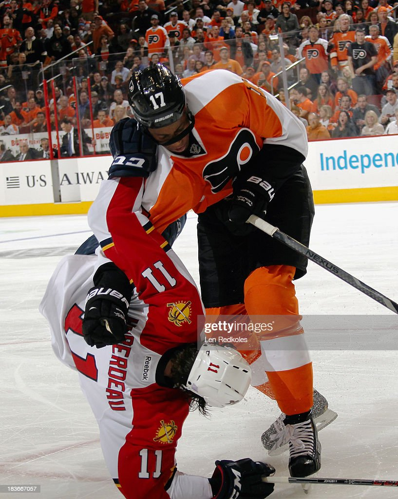 <a gi-track='captionPersonalityLinkClicked' href=/galleries/search?phrase=Wayne+Simmonds&family=editorial&specificpeople=4212617 ng-click='$event.stopPropagation()'>Wayne Simmonds</a> #17 of the Philadelphia Flyers checks <a gi-track='captionPersonalityLinkClicked' href=/galleries/search?phrase=Jonathan+Huberdeau&family=editorial&specificpeople=7144196 ng-click='$event.stopPropagation()'>Jonathan Huberdeau</a> #11 of the Florida Panthers to the ice on October 8, 2013 at the Wells Fargo Center in Philadelphia, Pennsylvania.