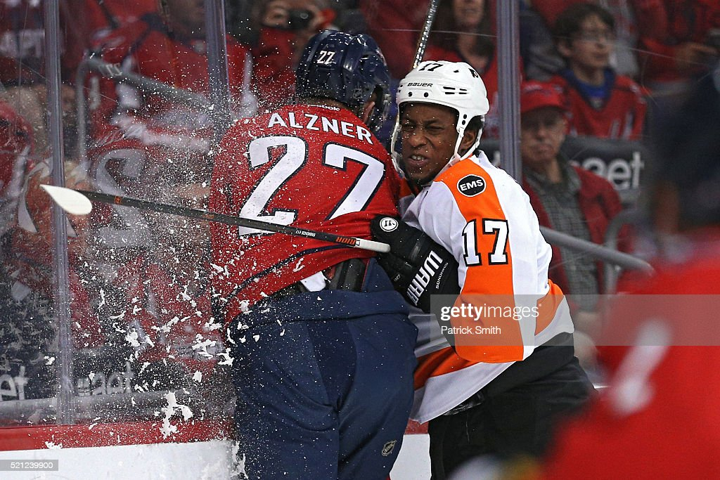 <a gi-track='captionPersonalityLinkClicked' href=/galleries/search?phrase=Wayne+Simmonds&family=editorial&specificpeople=4212617 ng-click='$event.stopPropagation()'>Wayne Simmonds</a> #17 of the Philadelphia Flyers checks <a gi-track='captionPersonalityLinkClicked' href=/galleries/search?phrase=Karl+Alzner&family=editorial&specificpeople=3938829 ng-click='$event.stopPropagation()'>Karl Alzner</a> #27 of the Washington Capitals during the first period in Game One of the Eastern Conference Quarterfinals during the 2015 NHL Stanley Cup Playoffs at Verizon Center on April 14, 2016 in Washington, DC.