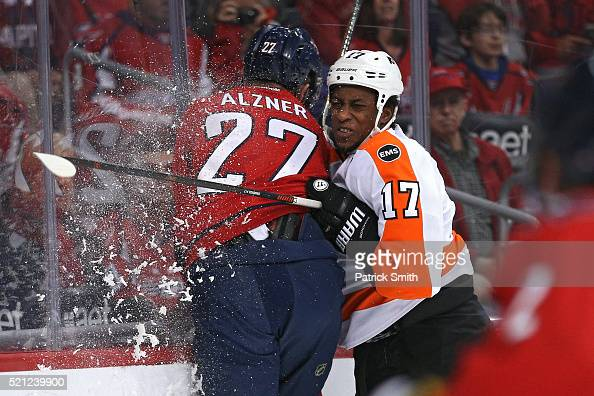 Wayne Simmonds of the Philadelphia Flyers checks Karl Alzner of the Washington Capitals during the first period in Game One of the Eastern Conference...