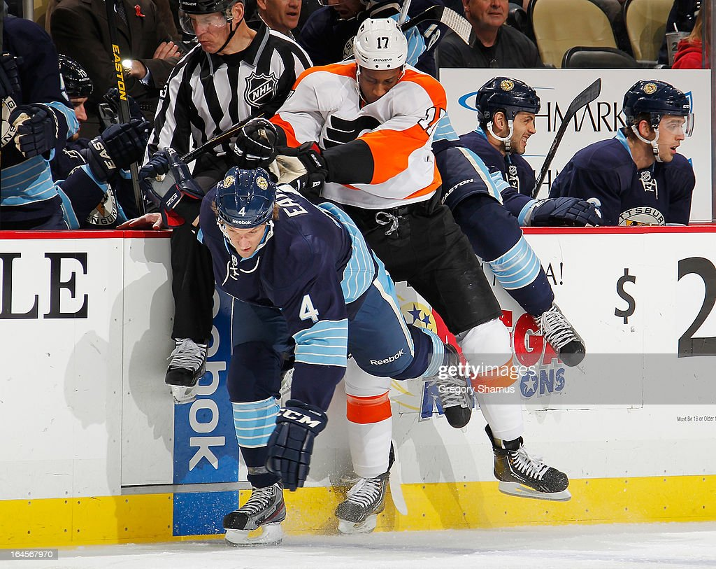 Wayne Simmonds #17 of the Philadelphia Flyers collides with Mark Eaton #4 of the Pittsburgh Penguins on March 24, 2013 at Consol Energy Center in Pittsburgh, Pennsylvania.