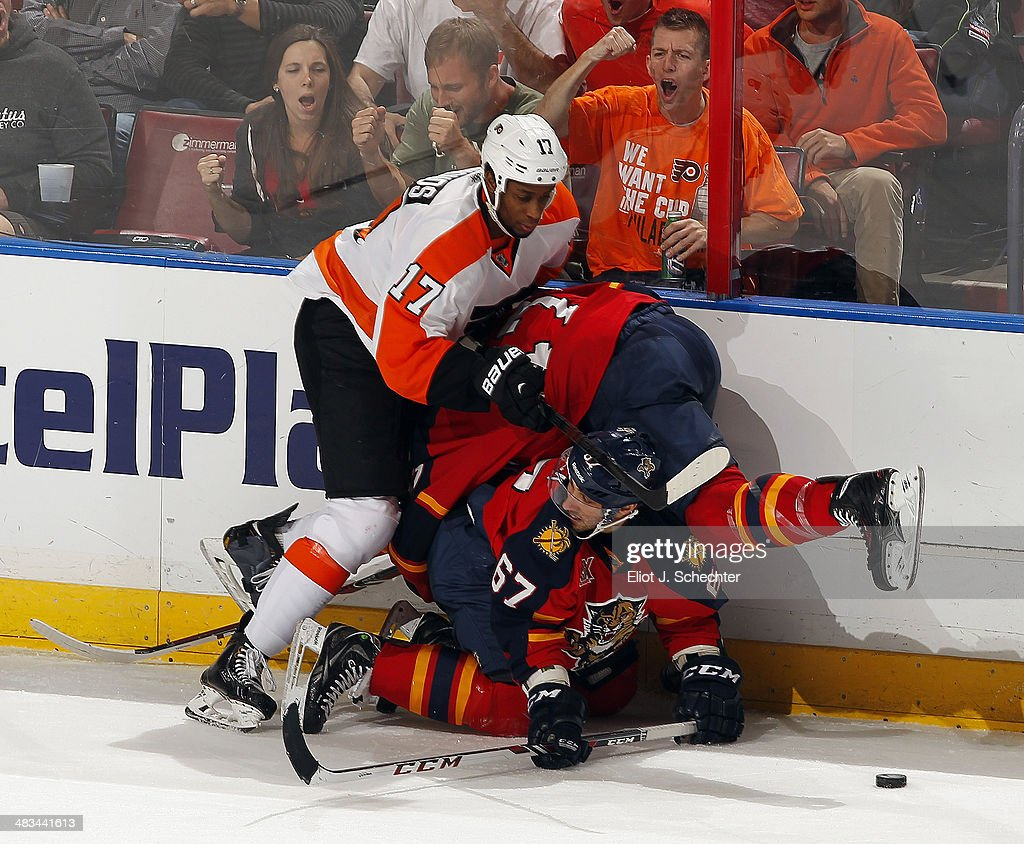 <a gi-track='captionPersonalityLinkClicked' href=/galleries/search?phrase=Wayne+Simmonds&family=editorial&specificpeople=4212617 ng-click='$event.stopPropagation()'>Wayne Simmonds</a> #17 of the Philadelphia Flyers collides with Vincent Trocheck #67 and <a gi-track='captionPersonalityLinkClicked' href=/galleries/search?phrase=Colby+Robak&family=editorial&specificpeople=4898162 ng-click='$event.stopPropagation()'>Colby Robak</a> #47 of the Florida Panthers at the BB&T Center on April 8, 2014 in Sunrise, Florida.