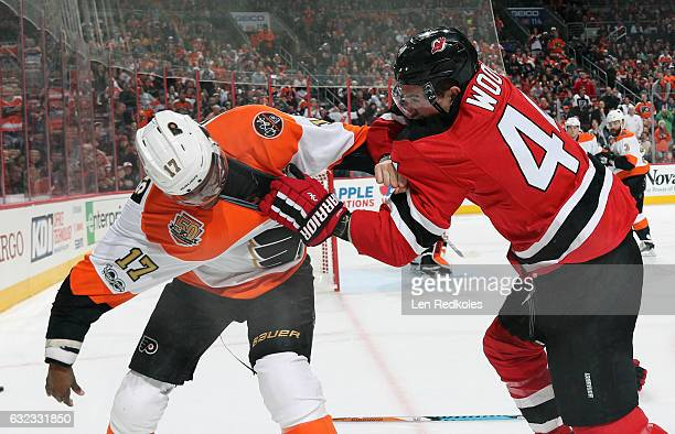 Wayne Simmonds of the Philadelphia Flyers fights Miles Wood of the New Jersey Devils in the first period on January 21 2017 at the Wells Fargo Center...