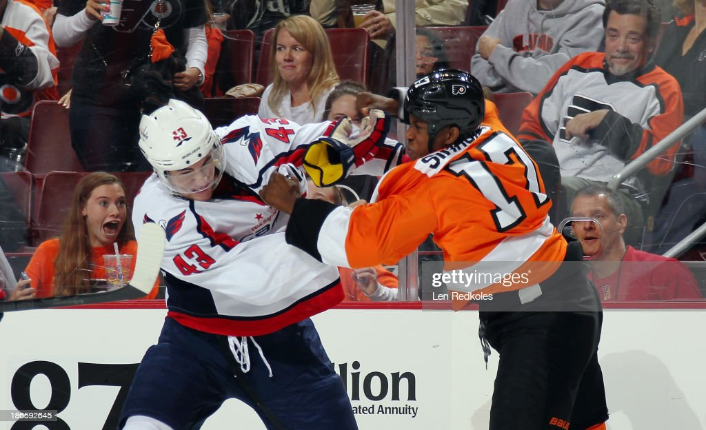 <a gi-track='captionPersonalityLinkClicked' href=/galleries/search?phrase=Wayne+Simmonds&family=editorial&specificpeople=4212617 ng-click='$event.stopPropagation()'>Wayne Simmonds</a> #17 of the Philadelphia Flyers fights Tom Wilson #43 of the Washington Capitals on November 1, 2013 at the Wells Fargo Center in Philadelphia, Pennsylvania. The Capitals went on to defeat the Flyers 7-0.