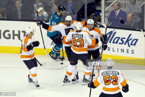Wayne Simmonds of the Philadelphia Flyers is congratulated by teammates after he scored in the third period against the San Jose Sharks at SAP Center...