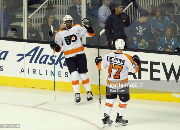 Wayne Simmonds of the Philadelphia Flyers is congratulated by Andrew MacDonald after he scored an empty net goal at the end of the third period for a...