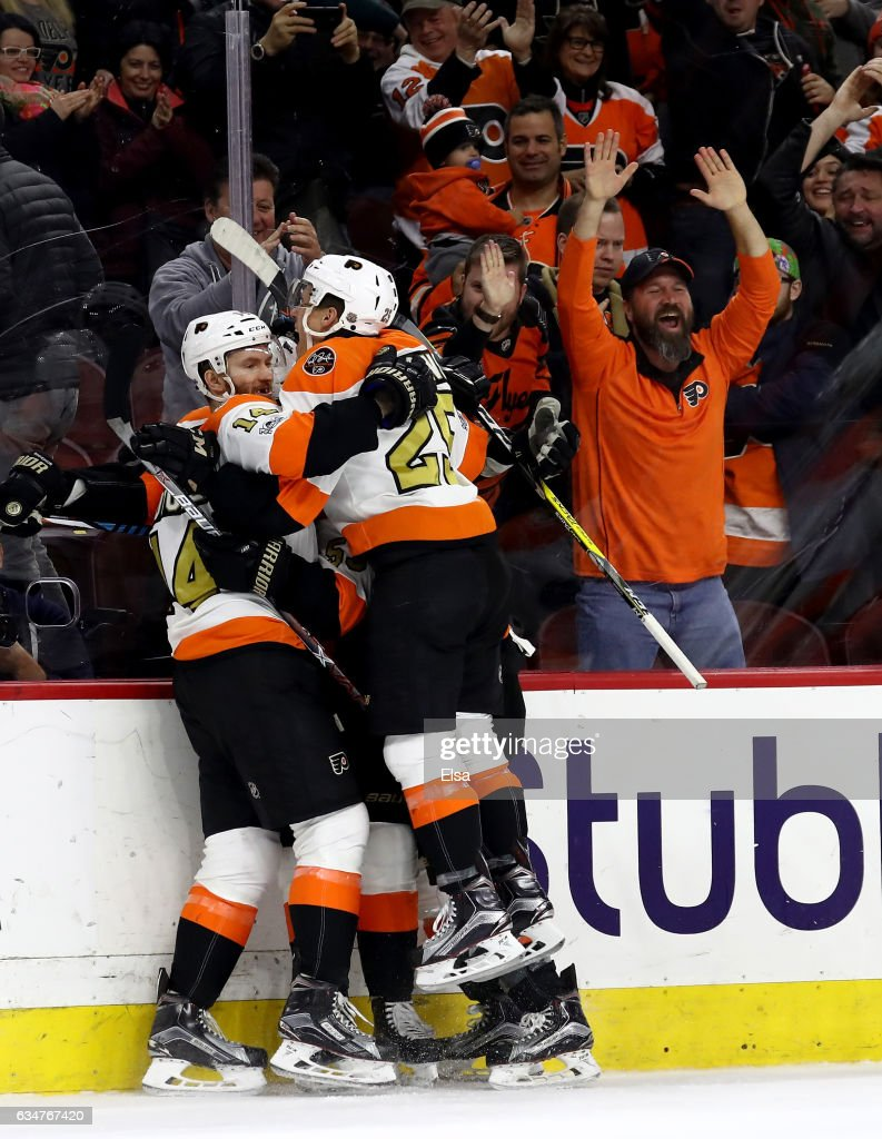 Wayne Simmonds #17 of the Philadelphia Flyers is congratulated by teammates Nick Cousins #25 and Sean Couturier #14 after Simmonds scored the game winning goal in overtiime against the San Jose Sharks on February 11, 2017 at Wells Fargo Center in Philadelphia, Pennsylvania.The Philadelphia Flyers defeated the San Jose Sharks 2-1 in overtime.