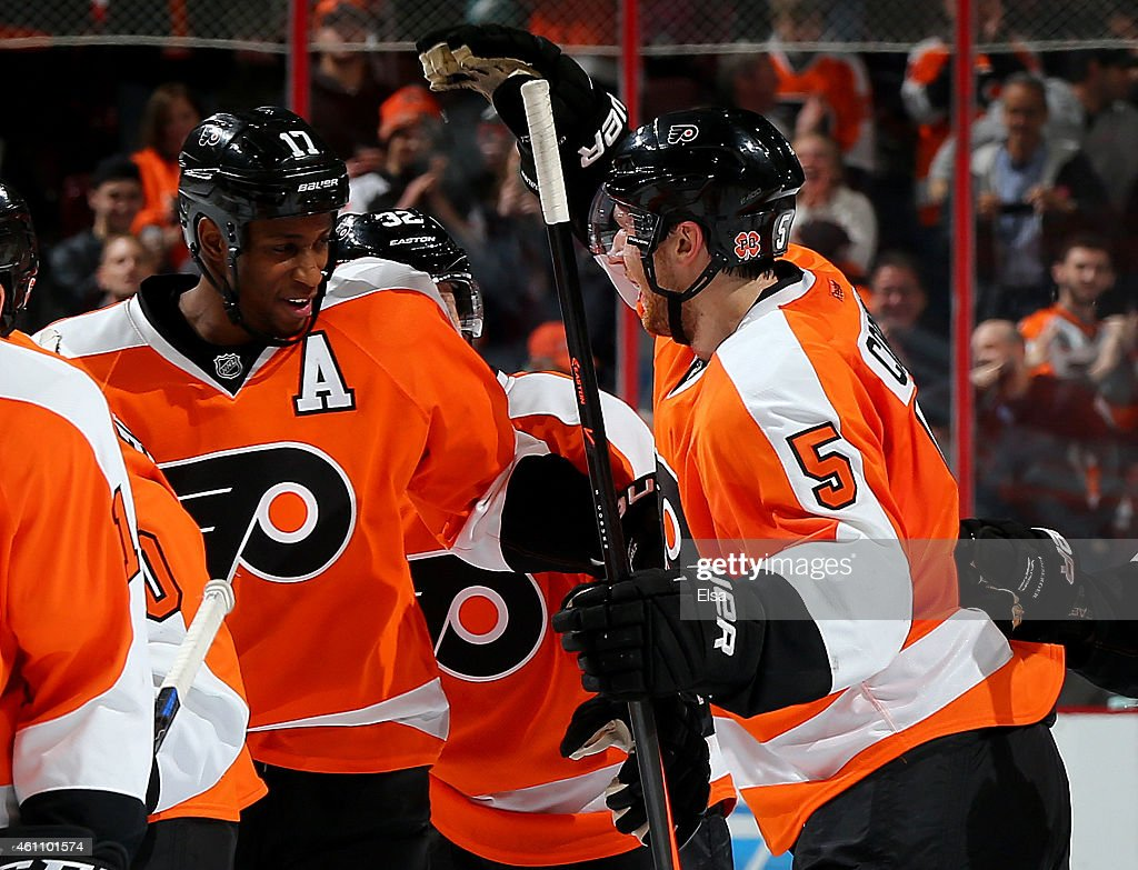 Wayne Simmonds #17 of the Philadelphia Flyers is congratulated by teammate Braydon Coburn #5 after Simmonds scored the game winner in an overtime shootout on January 6, 2015 at the Wells Fargo Center in Philadelphia, Pennsylvania.The Philadelphia Flyers defeated the Ottawa Senators 2-1 in an overtime shootout.