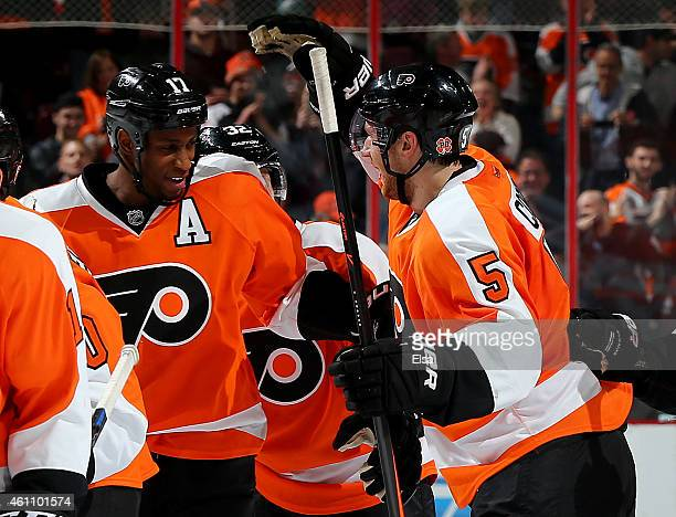Wayne Simmonds of the Philadelphia Flyers is congratulated by teammate Braydon Coburn after Simmonds scored the game winner in an overtime shootout...