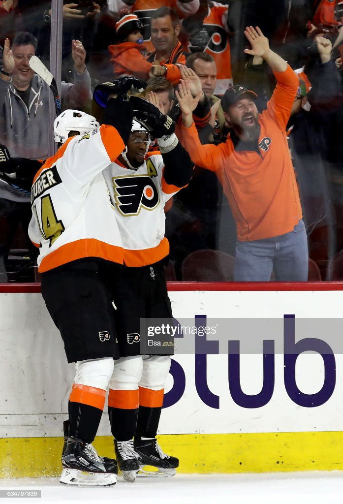 Wayne Simmonds #17 of the Philadelphia Flyers is congratulated by teammate Sean Couturier #14 after Simmonds scored the game winning goal in overtiime against the San Jose Sharks on February 11, 2017 at Wells Fargo Center in Philadelphia, Pennsylvania.The Philadelphia Flyers defeated the San Jose Sharks 2-1 in overtime.