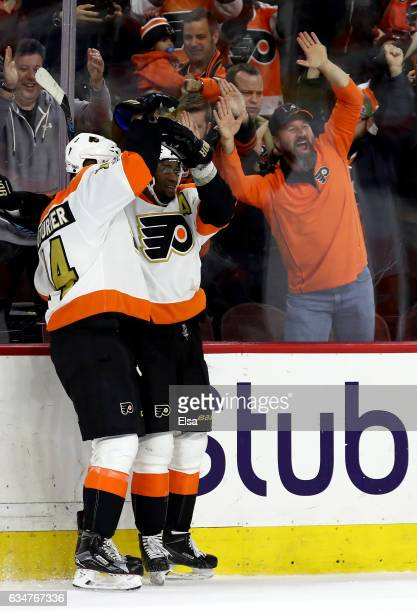 Wayne Simmonds of the Philadelphia Flyers is congratulated by teammate Sean Couturier after Simmonds scored the game winning goal in overtiime...