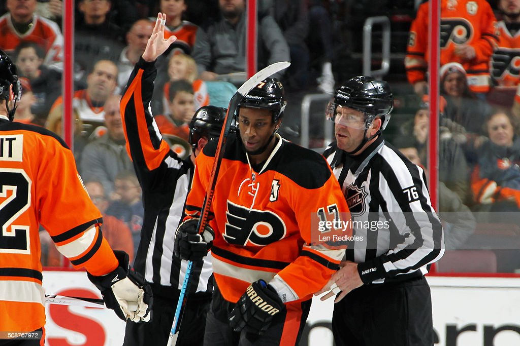 <a gi-track='captionPersonalityLinkClicked' href=/galleries/search?phrase=Wayne+Simmonds&family=editorial&specificpeople=4212617 ng-click='$event.stopPropagation()'>Wayne Simmonds</a> #17 of the Philadelphia Flyers is escorted off of the ice by Linesman Michel Cormier #76 after receiving a match penalty and a game misconduct during the first period in his game against the New York Rangers on February 6, 2016 at the Wells Fargo Center in Philadelphia, Pennsylvania.