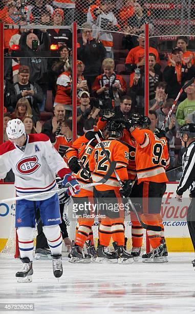 Wayne Simmonds of the Philadelphia Flyers is mobbed by teammates Mark Streit Jakub Voracek Vincent Lecavalier and Claude Giroux against the Montreal...