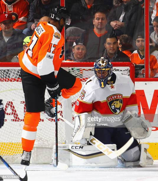 Wayne Simmonds of the Philadelphia Flyers jumps out of the way of a first period shot against Roberto Luongo of the Florida Panthers at the Wells...