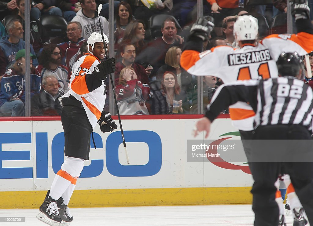 <a gi-track='captionPersonalityLinkClicked' href=/galleries/search?phrase=Wayne+Simmonds&family=editorial&specificpeople=4212617 ng-click='$event.stopPropagation()'>Wayne Simmonds</a> #17 of the Philadelphia Flyers reacts with teammate <a gi-track='captionPersonalityLinkClicked' href=/galleries/search?phrase=Andrej+Meszaros&family=editorial&specificpeople=617818 ng-click='$event.stopPropagation()'>Andrej Meszaros</a> #41 after scoring a goal against the Colorado Avalanche at the Pepsi Center on January, 2014 in Denver, Colorado.