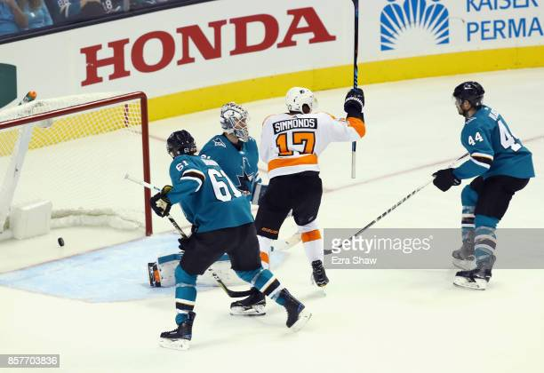 Wayne Simmonds of the Philadelphia Flyers scores a goal on Martin Jones of the San Jose Sharks in the third period at SAP Center on October 4 2017 in...