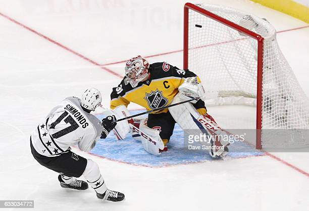 Wayne Simmonds of the Philadelphia Flyers scores past Carey Price of the Montreal Canadiens during the Metropolitan Division and Atlantic Division...