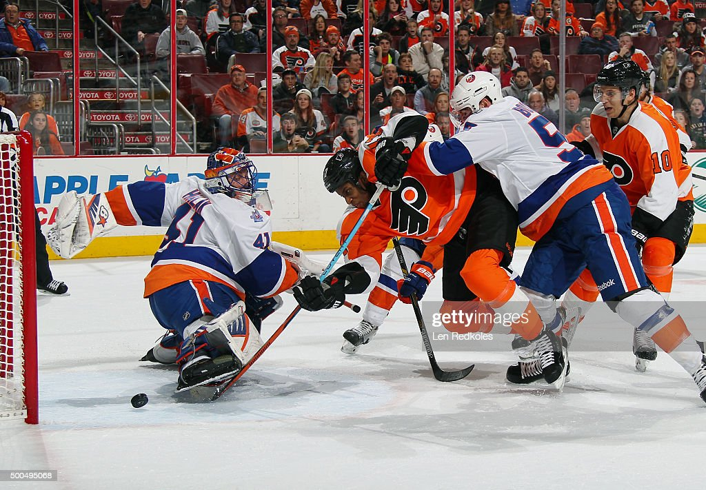 Wayne Simmonds of the Philadelphia Flyers sends the puck past goaltender Jaroslav Halak of the New York Islanders during a power play in the second...